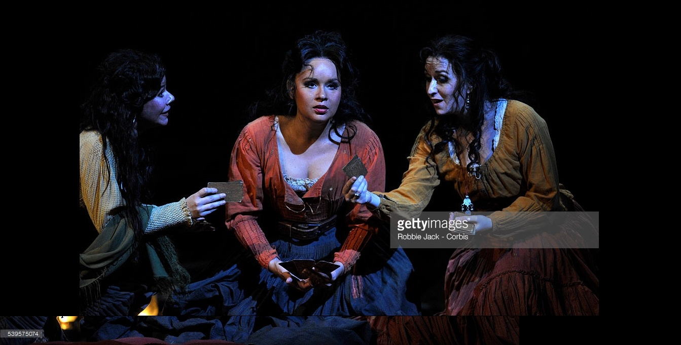Vlada Borovko as Frasquita, Elena Maximova as Carmen and Michele Losier as Mercedes in the Royal Opera's production of Georges Bizet's Carmen directed by Francesca Zambello and conducted by Bertrand de Billy at the Royal Opera House Covent Garden in London.